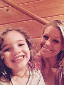 Ashley Peszynski Durval is hoping to move her family to Colorado so cannabis oil can be easily obtained for daughter Harper Grace, left, who suffers from epilepsy seizures.