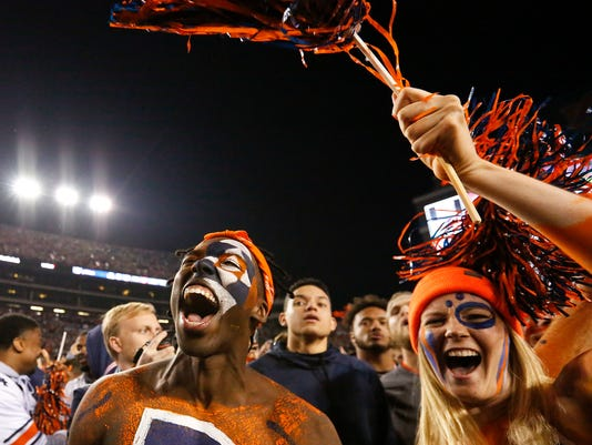 Fans cheer as they rush the field after Auburn defeated Alabama 26-14 in the Iron Bowl NCAA college football game, Saturday, Nov. 25, 2017, in Auburn, Ala. (AP Photo/Brynn Anderson)