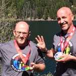 Great Falls dentist Eugene Tynes, right, completed a Spartan Trifecta with his friend Brett Weber, left. A Spartan Trifecta is doing all three Spartan distances in a calendar year.