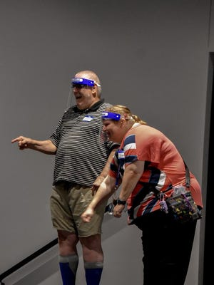 "Jimmy Tucker and Laverne Gitchel act out a game called ""Build the Machine"" during the five-day Center Stage Theatre Camp for people with disabilities in the Hays area, held at Celebration Community Church."