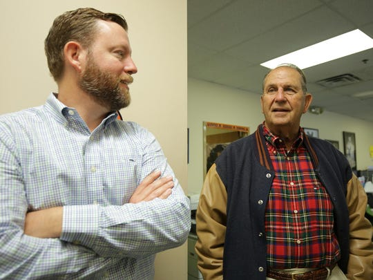 Tom Keen, 44, left, stands with Jim Keen, 74, at Cliff Keen Athletics in Ann Arbor. Cliff Keen, the legendary Michigan wrestling coach, started the wrestling apparel and equipment company. Jim is his son. Tom is his grandson and now runs the company.