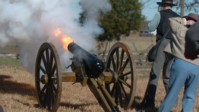 A canon is fired northward toward where Confederate soldiers would have been during the Civil War during the 2011 Parkers Crossroads Battlefield Association's walking tour on the 149th anniversary of the Civil War.