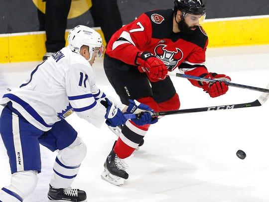 Defenseman Brian Strait skates past a Toronto Marlies player on Jan. 20.