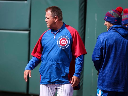 Iowa Cubs' manager Marty Pevey watching work outs during