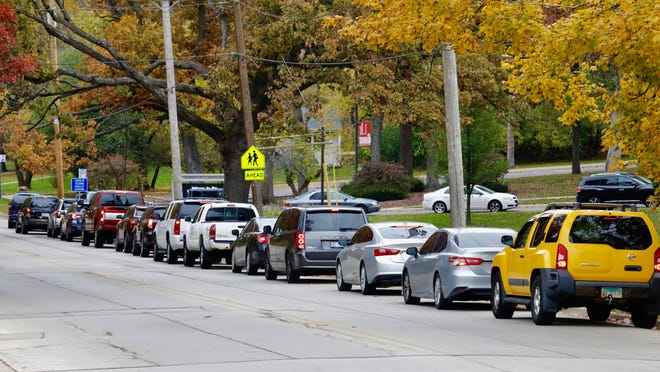 Vehicles spill out of a COVID-19 testing area Monday, Oct. 26, 2020, at the University of Illinois College of Medicine-Rockford and line Parkview Avenue.