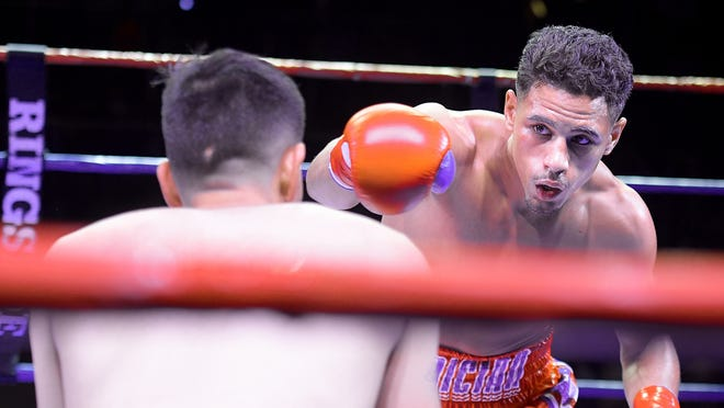 Worcester lightweight Jamaine Ortiz sizes up his opponent, Luis Ronald Castillo of Mexico, during their boxing match at the Palladium in February. Ortiz, who on the fight, hasn't fought since, due in large part to the coronavirus pandemic.