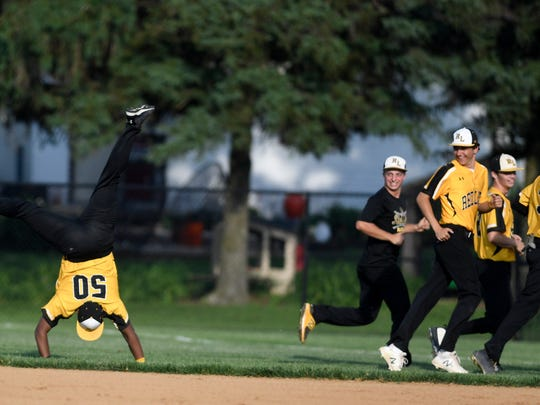 Teammates watch as Raquwan Bradford does cartwheels across the field after Red Lion beat Dallastown 4-1 in the District 3 Class 6-A baseball semifinal game at Spring Grove, Tuesday, May 29, 2018. John A. Pavoncello photo
