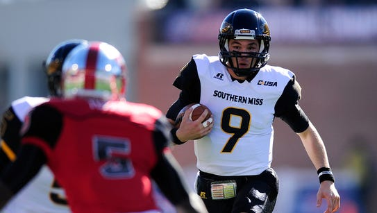 Southern Miss quarterback Nick Mullens (9) and the