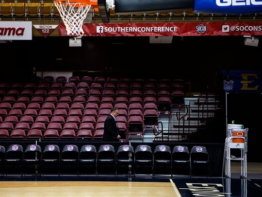 Staff get ready Wednesday afternoon for the start of the Southern Conference tournament at the U.S. Cellular Center.