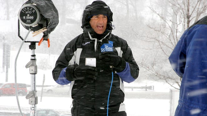 Jim Cantore, storm tracker and on-camera meteorologist on the cable network The Weather Channel, covering winter storms in Milwaukee in 2007.
