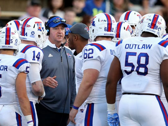 Louisiana Tech Bulldogs head coach Skip Holtz talks to his players in the second quarter of their game against the Southern Miss Golden Eagles at M.M. Roberts Stadium.