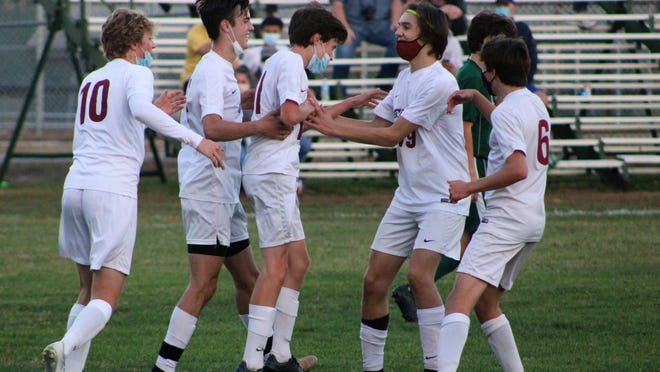 Portsmouth's Michael Donahue, center, is congratulated by teammates after scoring the game's final goal late in the second half.