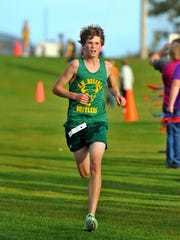 Cooper West heads for the finish line during a Crosstown Cross Country Meet at Anaconda Hills Golf Course.