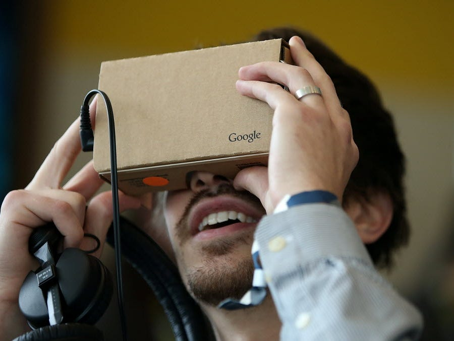 An attendee inspects Google Cardboard during the 2015 Google I/O conference on May 28, 2015, in San Francisco.