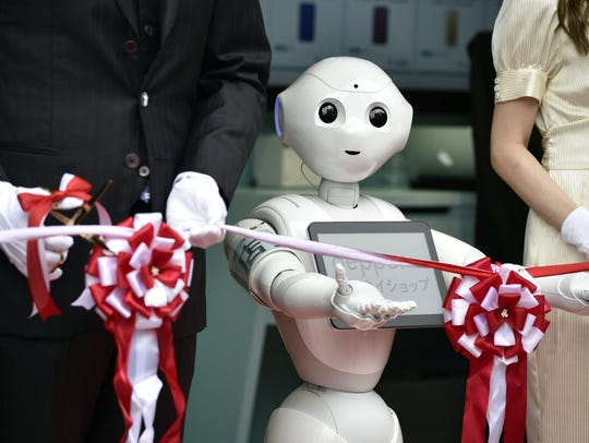 Pepper the robot participates in a Japanese ribbon-cutting