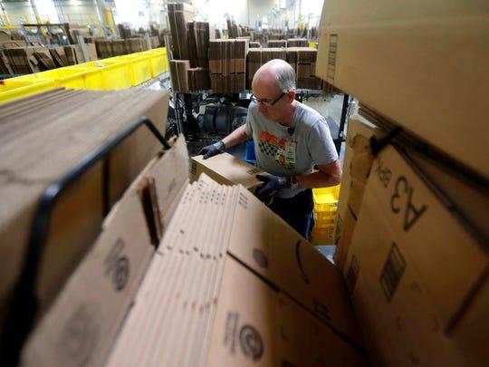 In this Tuesday, Aug. 1, 2017, photo, Amazon employee