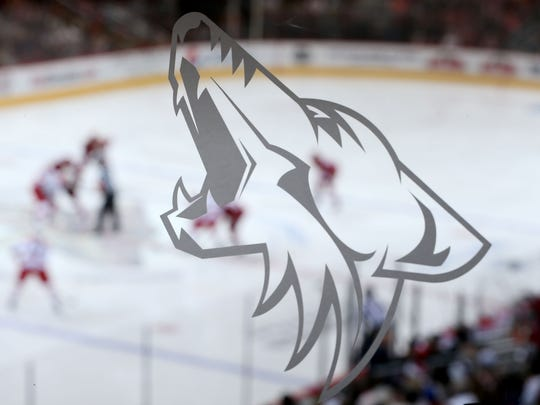 The Arizona Coyotes logo is depicted on glass at the Gila River Arena.