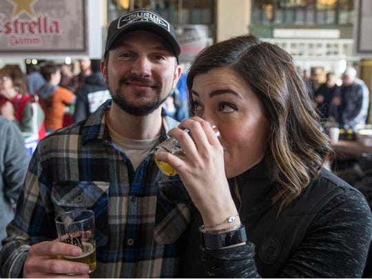 David Ullman and Lauren Brescia, both of Robbinsville, enjoy beer as the Asbury Park Beerfest gets underway at Convention Hall on the boardwalk on Jan. 27.