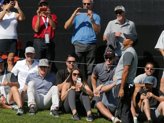 Tiger Woods reacts after missing a birdie putt on the ninth hole during the first round of the Genesis Open at Riveria Country Club in Pacific Palisades. Woods shot a 1-over-par 72.