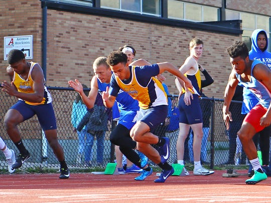 R.J. Khayo, center, from Moeller gets out of the blocks fast and sets a new meet record of 10.99 seconds for the 100 meter dash at the Anderson Invitational track meet at Anderson High School.