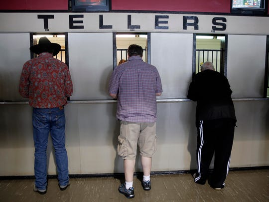 Fans place bets on the  races before the 139th Preakness
