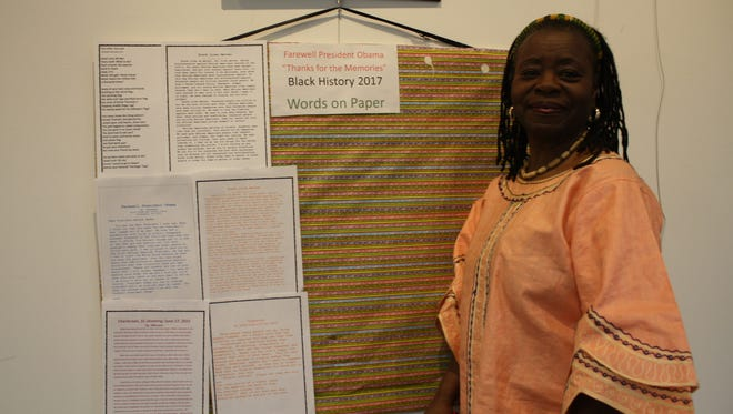 Brenda Brown, 69, of Endwell, next to farewell letters to Barack Obama written by local students. Brown is the curator of  the Black History Month Celebration of Champions at the Broome County Public Library.