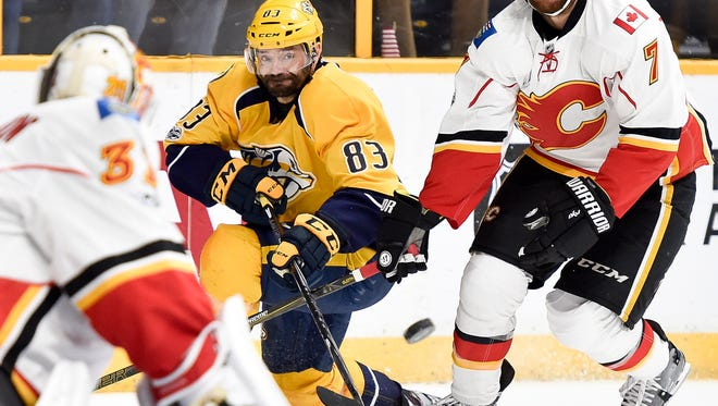 Predators center Vernon Fiddler (83) passes past Calgary Flames defenseman TJ Brodie (7) during the first period March 23, 2017, at Bridgestone Arena.