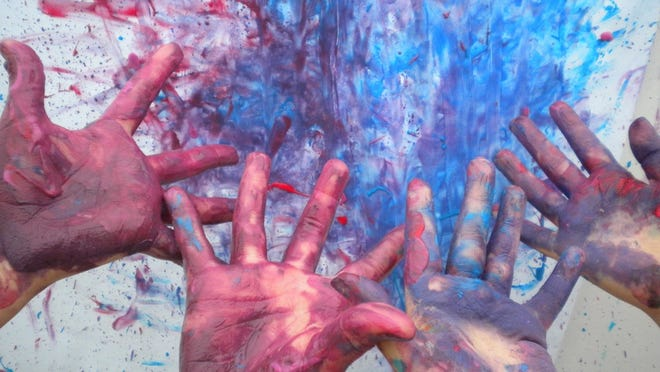 Kids show off their colorful hands.