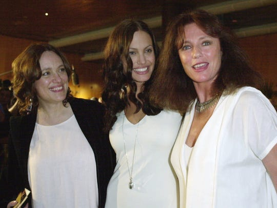 Angelina Jolie, center, is joined by her mother Marcheline Bertrand, left, and actress Jaqueline Bisset in 2001.