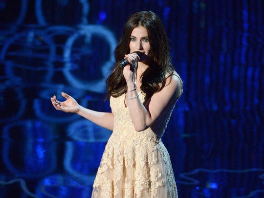 """Idina Menzel performing during the Oscars at the Dolby Theatre in Los Angeles. John Travolta accidentally introduced her as """"Adele Dazeem."""""""