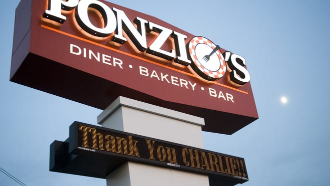 "?Thank You Charlie? is displayed on Ponzio's sign on Route 70 Friday. For the past three years, the former Phillies manager conducted a radio show once a month during baseball season at the restaurant. Ponzio?s co-owner John Fifis was sad when he heard about Manuel. ?It?s a sad day for the fans and I feel badly for him. He is a great guy and I hate to see him go, but that?s baseball.? Fifis said customers loved seeing Manuel. ?He never refused an autograph and spent time in conversation with them talking baseball.? JODI SAMSEL/Courier-Post ""Thank You, Charlie"" is displayed on Ponzio's sign on Rte 70, August 16, 2013 in Cherry Hill."