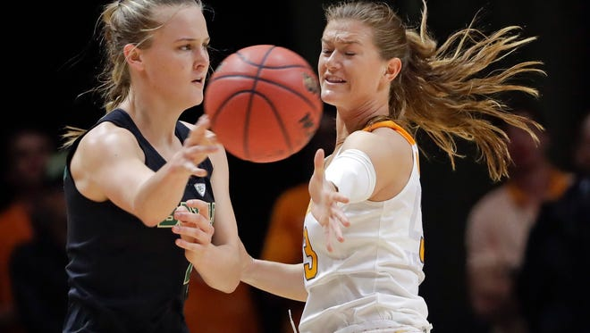 Baylor guard Kristy Wallace, left, passes past Tennessee guard Alexa Middleton, right, in the first half of an NCAA college basketball game Sunday, Dec. 4, 2016, in Knoxville, Tenn. (AP Photo/Mark Humphrey)