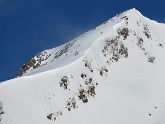 The winter route to Mount St. Helens' summit follows this windswept ridge.