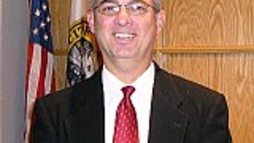 County to investigate charge against councilman