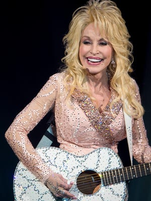 """Dolly Parton performs at the LeConte Center in Pigeon Forge as part of her """"Pure & Simple"""" tour on Tuesday, Nov. 15, 2016."""