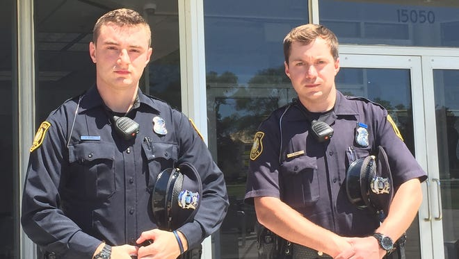 Livonia officers Dominic Michels (left) and Alex Maher in July used a specialized tourniquet to rescue a woman whose left arm was bleeding profusely. The tourniquets now carried by all Livonia officers were purchased with a $9,000 grant from Spirit of Blue.