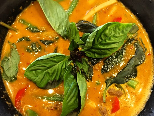 Chicken with red curry from District Thai in North