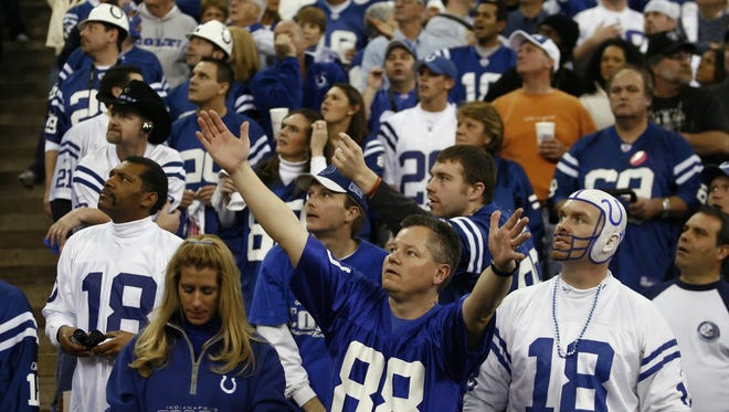 Colts fans watch a replay of a New England touchdown on a stadium monitor, during first quarter action.  Colts defeated the New England Patriots 38-34, AFC title game, RCA Dome, Indianapolis, IN, Sunday, January 21, 2007.