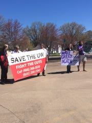Community members protest cuts to the University of