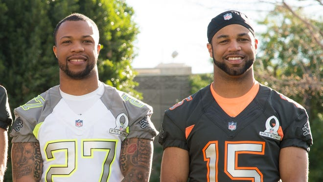 Detroit Lions players Glover Quin (27) and Golden Tate pose during photo day for the 2015 Pro Bowl.