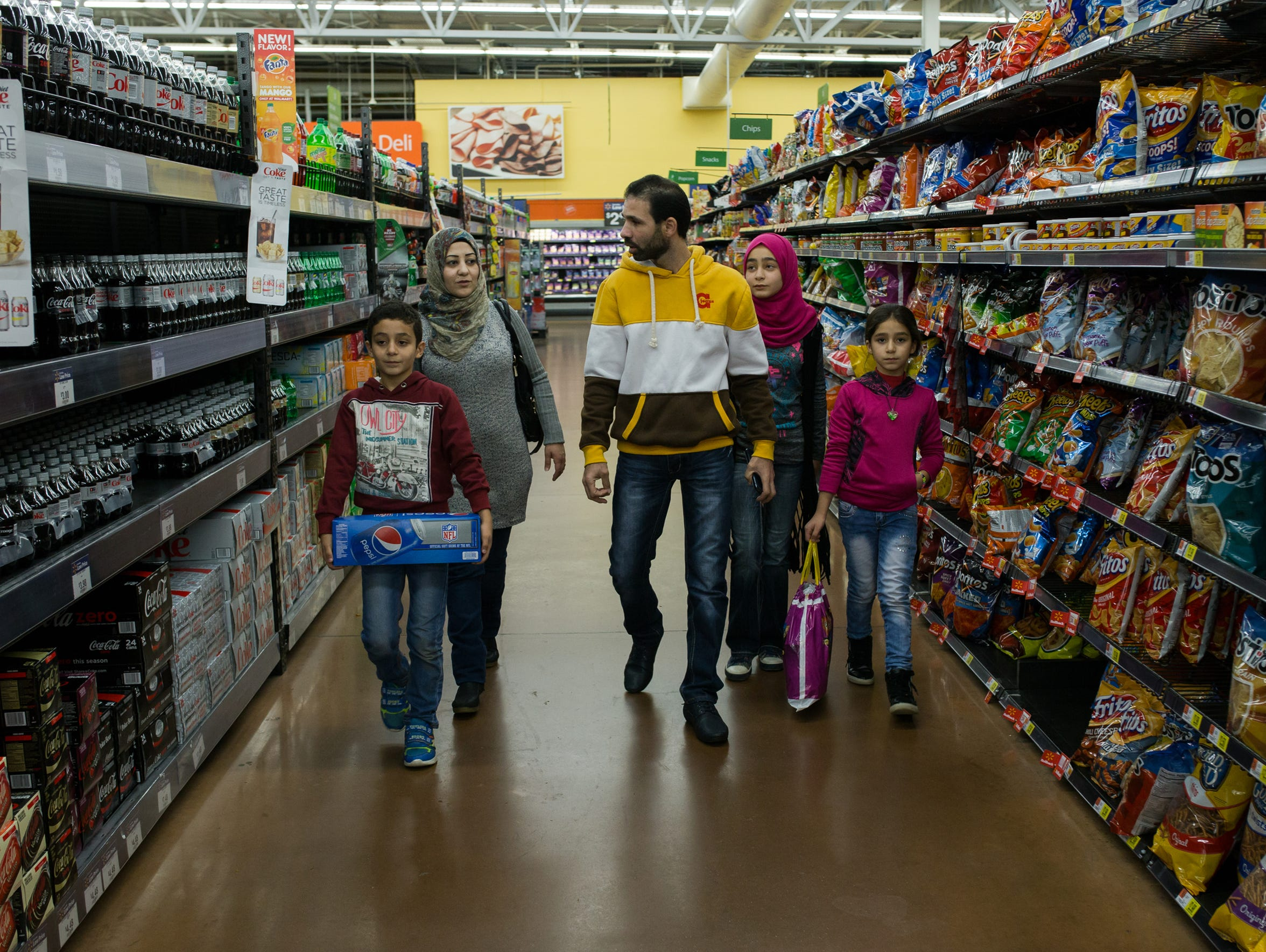The Sharaf family, Syrian refugees, shops at Walmart