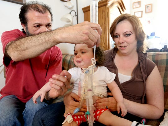 Phoenix Ott, 2, and her parents, Scott Ott and Victoria Nikirk, have been told they must vacate their Salem rental home after their landlord didn't pay the mortgage with their monthly rent payments. Phoenix was born weighing less than one pound and relies on a ventilator to breathe. Photographed on Wednesday, May 11, 2016.
