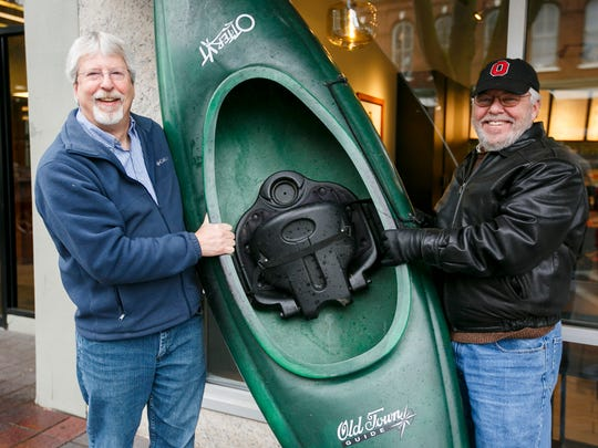 Jon Yoder, left, and John Russell, right, brought a kayak to Holding Court on Tuesday, Jan. 10, 2017. The two are on the board of Salem Environmental Education, which is hosting an Outdoor Adventure Series talk about kayaking and canoeing on Jan. 18.