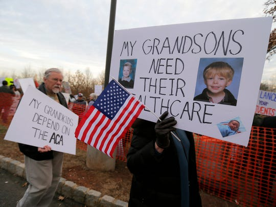 Dave and Karan Richardson of Califon attend a rally before Congressman Leonard Lance's town hall meeting at Raritan Valley Community College in Branchburg on Feb. 22, 2017.