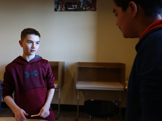 """Seventh grader Tyler Wilson, left, interviews seventh grader Pedro Govea during a journalism club meeting at Straub Middle School in West Salem on Thursday, Feb. 23, 2017. West Salem High School and Straub Middle school students are working together on """"Stories for Salem"""", a project highlighting diversity in Salem. The project will be unveiled at a free presentation on April 7 at West Salem with special guest speakers."""
