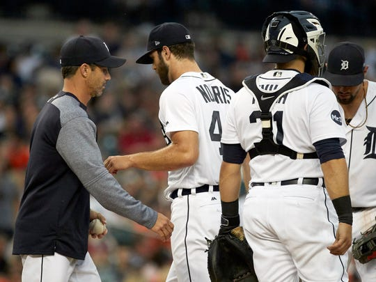 Jun 28, 2017; Detroit, MI, USA; Tigers manager Brad Ausmus takes the ball to relieve starting pitcher Daniel Norris in the fourth inning against the Royals at Comerica Park.