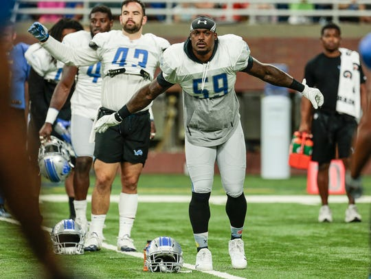 Lions linebacker Tahir Whitehead stretches at Ford