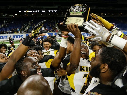 Detroit King players celebrate after winning the Detroit