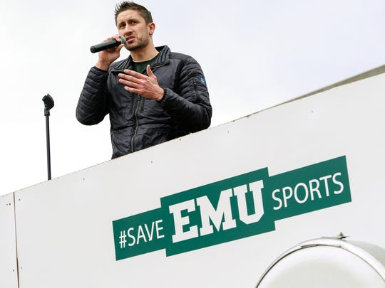 Kevin Doak speaks to students, athletes, faculty and alumni during a rally to save Eastern Michigan University sports on Monday, April 17, 2018, outside the EMU Convocation Center in Ypsilanti.