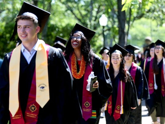 Graduates walk to the Willamette University College